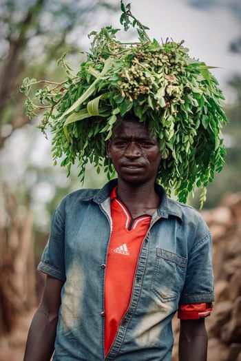 Omo Valley Tribe Ethiopian African Portrait Photography Travel Destinations Travel Tribal Ethiopia Ethiopian Photography 🇪🇹 Real People Front View One Person Plant Casual Clothing Leisure Activity Lifestyles Standing Day Young Adult Portrait Nature Tree Young Men Focus On Foreground Looking Green Color Outdoors Adult Men