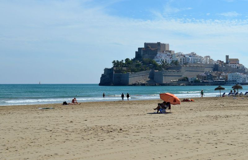 Castle Peñíscola SPAIN Adult Architecture Beach Beauty In Nature Building Exterior Built Structure City Day Horizon Over Water Leisure Activity Lifestyles Men Nature Outdoors People Real People Sand Sea Shore Sky Vacations Water