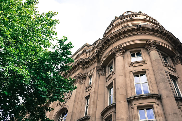 Arch Architectural Feature Architecture Building Exterior Building Story Built Structure City City Life Day Façade Historic History Low Angle View No People Old Town Outdoors Sky Tree Window