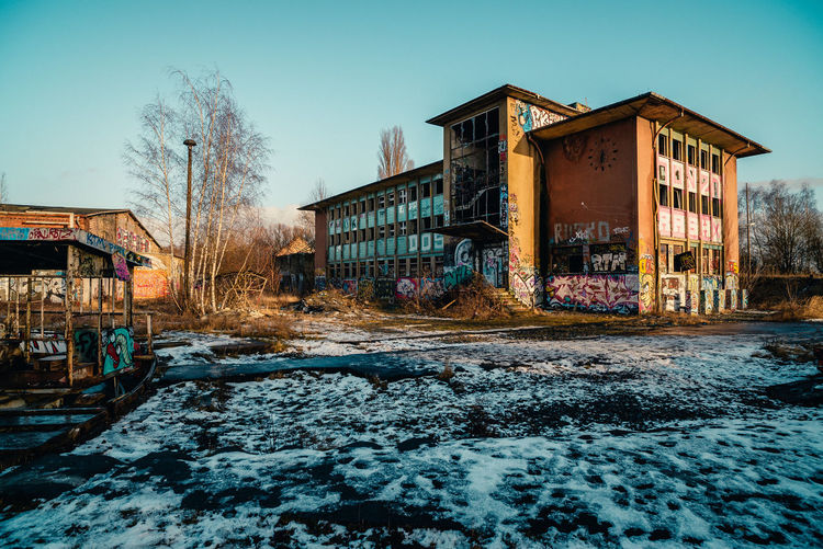 Abandoned Abandoned Buildings Abandones Places Architecture Bare Tree Building Exterior Built Structure City Clear Sky Cold Temperature Day Deserted Deserted Places Empty House Frightening Graffiti Loneliness Lost Places No People Outdoors Sky Snow Snowing Tree Winter