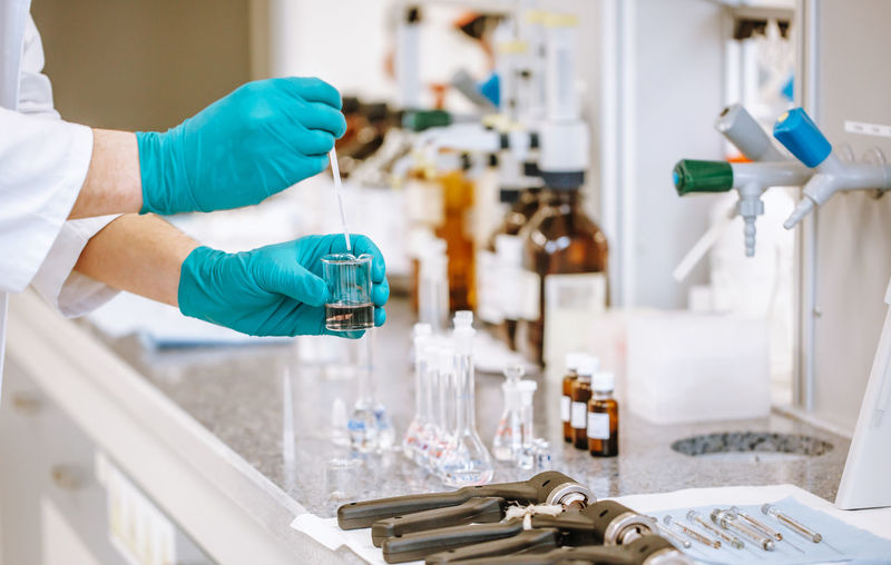 Cropped hands of scientist experimenting at laboratory
