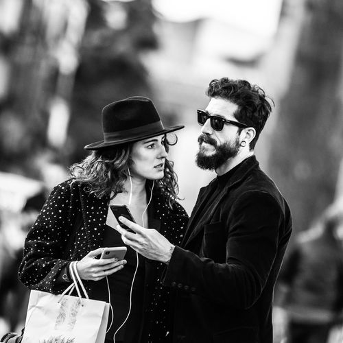 """""""Couple"""" Young Adult Young Men Real People Focus On Foreground Young Women Clothing Lifestyles Men Two People People Adult Incidental People Women Standing Casual Clothing Communication Leisure Activity Looking Fashion Couple - Relationship The Art Of Street Photography My Best Photo"""