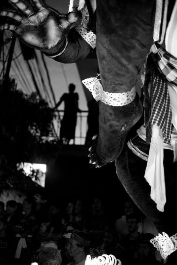 enjoying the ogoh-ogoh festivities from above. https://balistreetphotographer.com/portfolio/ogoh-ogoh-balis-macys-day-parade/ Bali Fine Art Photography Nyepi Silhouette Travel Wanderlust Balinese Culture Black And White Focus On Foreground Leisure Activity Lifestyles Low Section Monochrome Ngrupuk Ogoh-ogoh One Person Outdoors Pengerupukan People Real People Street Photography