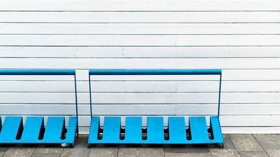 Bicycle racks against white wall