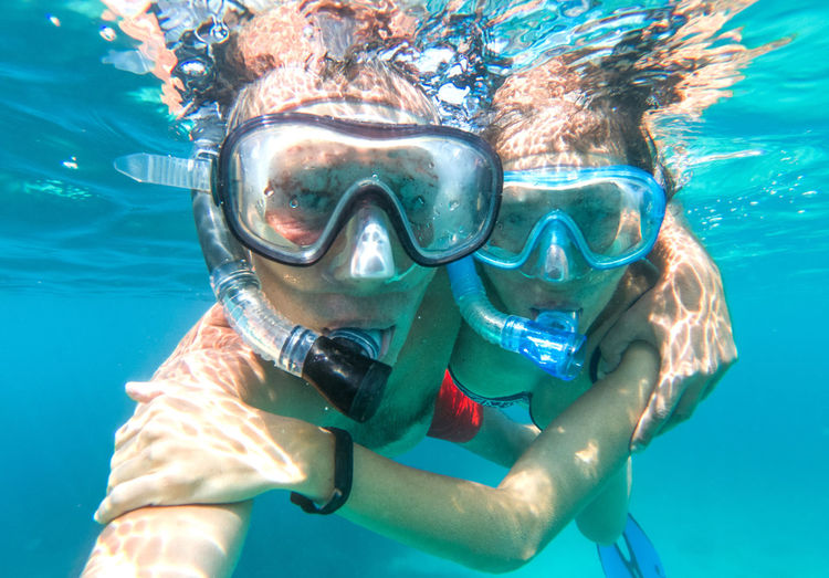 Underwater photo of a couple snorkeling in tropical sea Underwater Sea Sport Water Aquatic Sport Swimming Snorkeling Scuba Diving UnderSea Swimwear Scuba Mask Adventure Holiday Vacations Eyewear Leisure Activity Underwater Diving Nature Couple Couple - Relationship Honeymoon Lovers Ocean Tropical Paradise Holiday