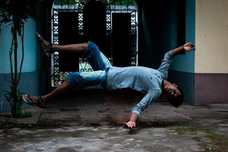 Full length of man relaxing on floor