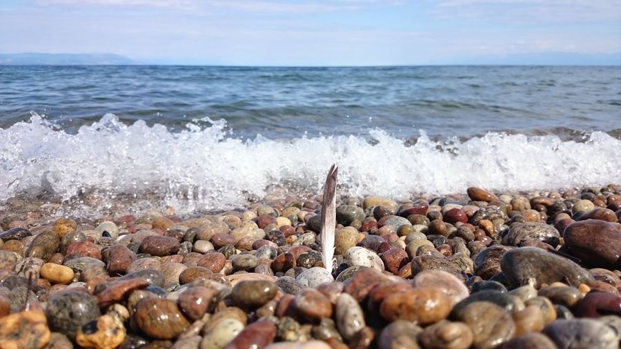 Sea Water Horizon Over Water Beach Surf Shore Scenics Wave Pebble Tranquil Scene Ocean Travel Destinations Motion Seascape Stone - Object Nature Beauty In Nature Large Group Of Objects Calm Breaking