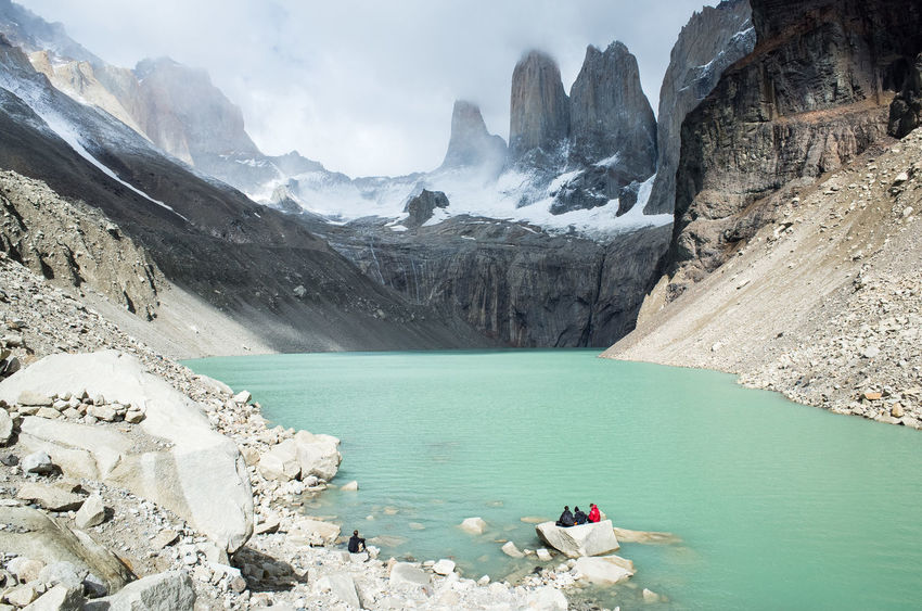 Sitting by the Torres Chile Beauty In Nature Cold Temperature Day Environment Ice Laguna De Torres Lake Landscape Mountain Mountain Peak Mountain Range Nature Non-urban Scene Outdoors Rock Rock - Object Scenics - Nature Snow Solid Torres Del Paine Tranquil Scene Tranquility W-trek Water