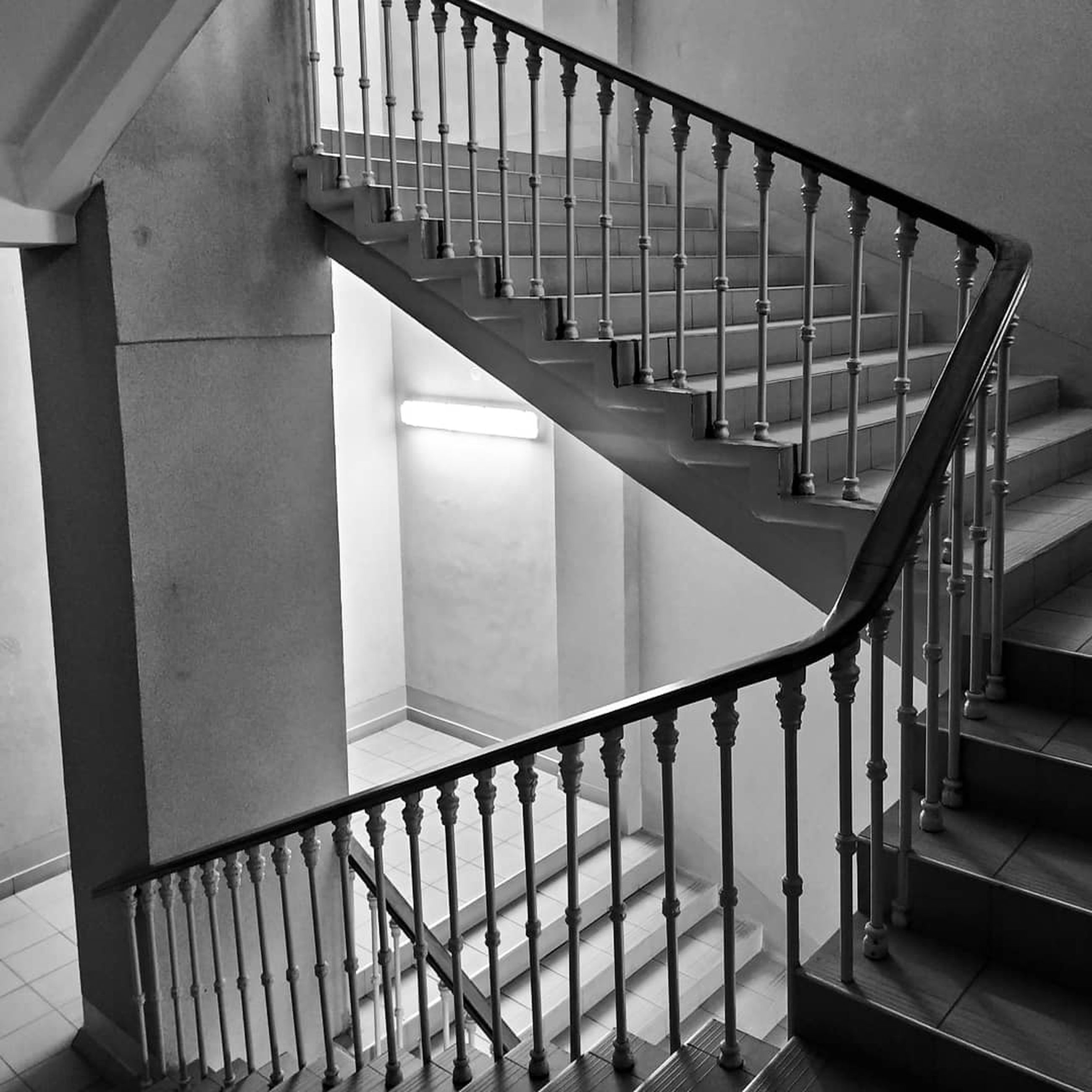 steps and staircases, staircase, architecture, railing, built structure, indoors, no people, building, absence, pattern, day, repetition, empty, metal, balustrade, in a row, wall - building feature, diminishing perspective, spiral