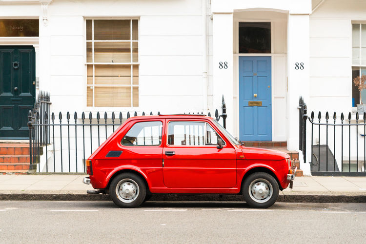 Typical Red Car in London Car City Colourful House Front London Londonian Parked Car Street Urban