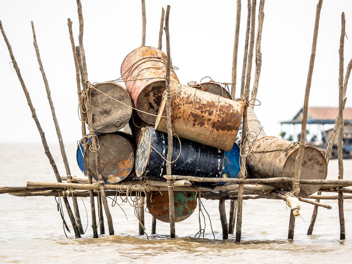 Adult Adults Only Animal Themes Barrel Barrels Cambodia Casks Close-up Cowboy Hat Day Floating Floating Village Horse Kambodscha Mammal One Person Outdoors People Tonle Sap Lake Tonlesap Travel Travel Destinations Travel Photography White Background Working Animal