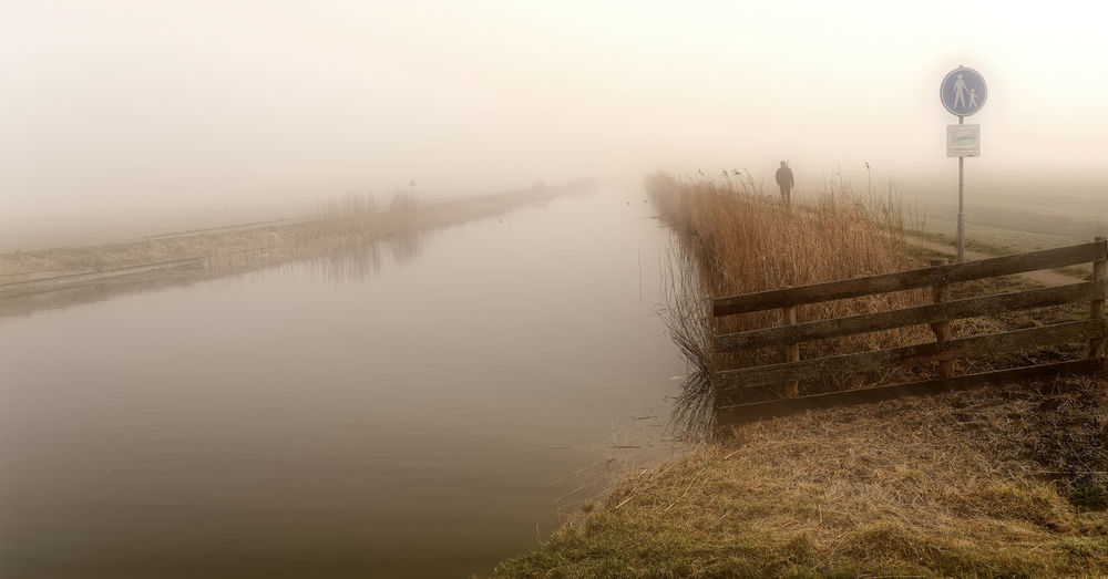 Fading Beauty In Nature Cold Temperature Day Fog Foggy Grass Lake Mist Nature No People Outdoors Scenics Sky Tranquil Scene Tranquility Water Weather Winter