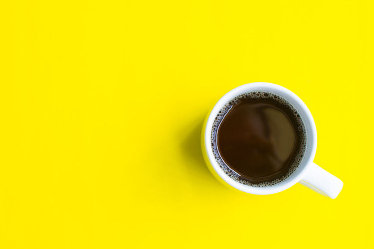 Coffee Drink Cup Coffee - Drink Food And Drink Yellow Coffee Cup Mug Refreshment Directly Above Still Life Copy Space Freshness Indoors  No People Studio Shot Close-up Table Cut Out Hot Drink Crockery Non-alcoholic Beverage Tea Cup