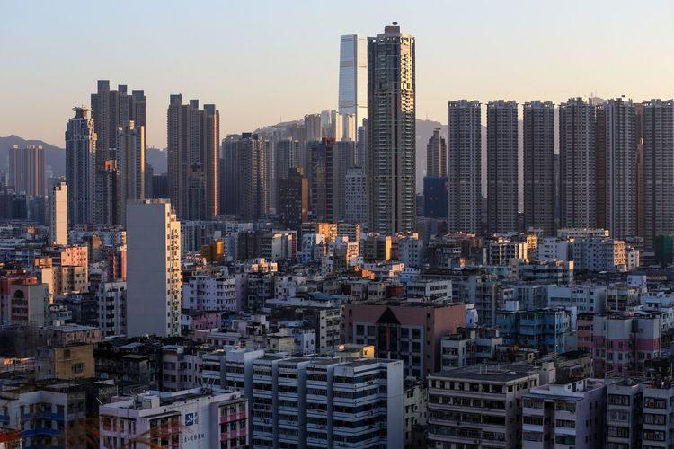 Cityscape against sky during sunrise