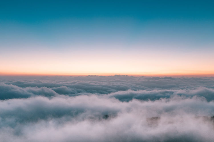 Aerial view of landscape against sky at sunset