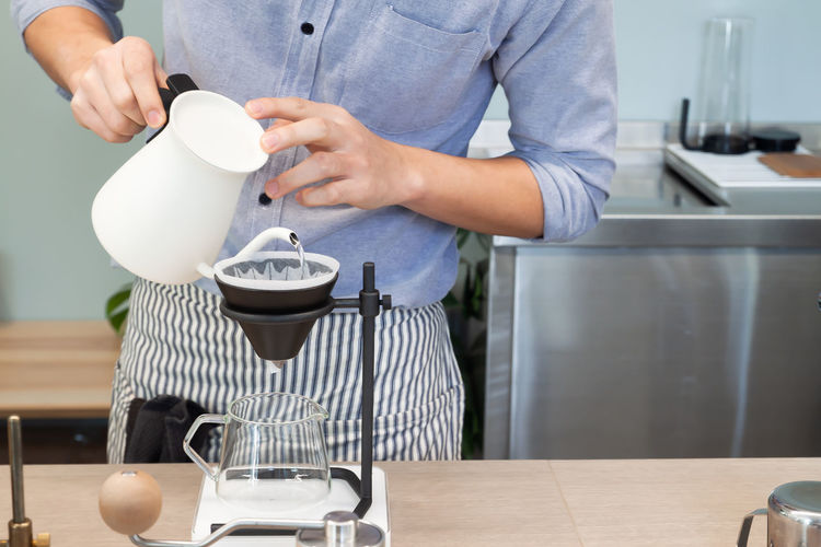 Coffee Apron Drip Brew Cafe Cafeteria Pouring Concept One Person Kitchen Food And Drink Preparation  Pouring Barista Dripping Drip Coffee Man Cafe Restaurant Drink Baverage Lifestyle Business Making Brewing Brew Breakfast People Advertisement Advertising