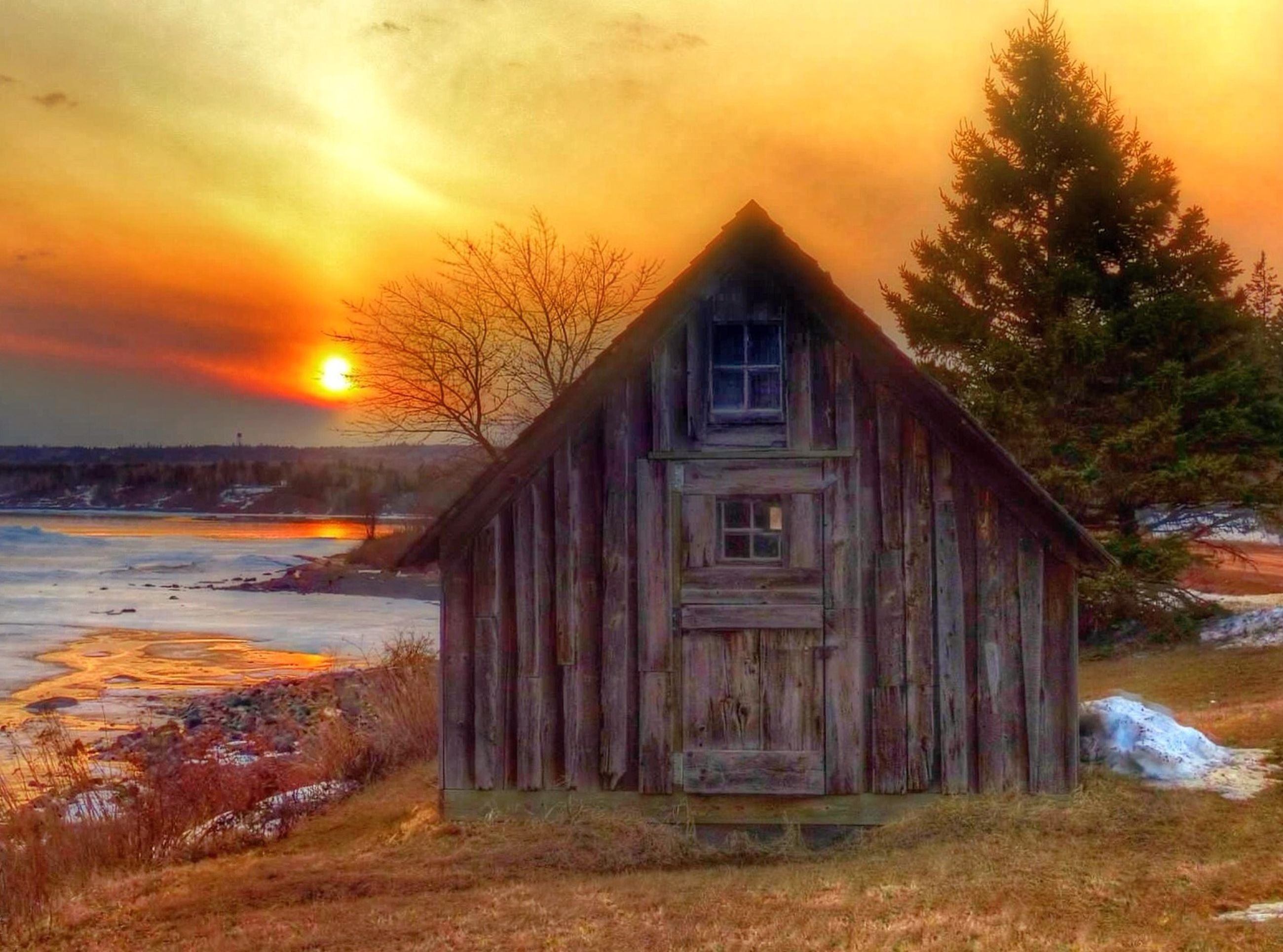 architecture, built structure, building exterior, sunset, house, window, wood - material, sunlight, orange color, wall - building feature, residential structure, building, no people, outdoors, sun, sunbeam, tree, residential building, brick wall