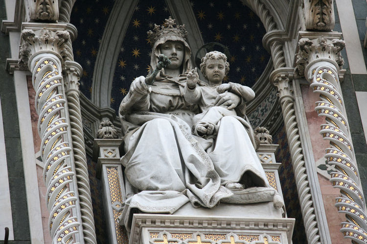 Low angle view of statue against building in florence italy