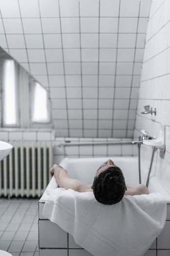 Man Resting In Bathtub