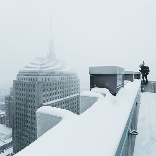 Winter Snow Cold Temperature Architecture Building Exterior Real People Built Structure Outdoors City Day Snowing Nature Cityscape