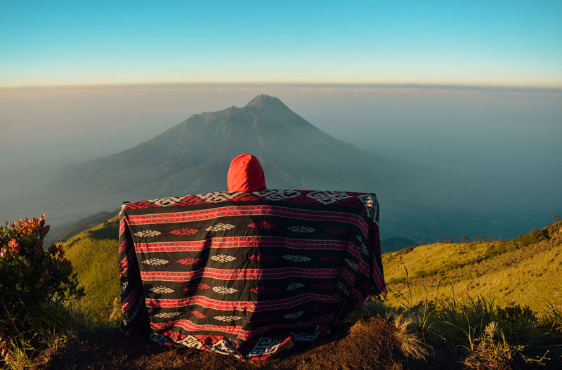 Enjoy the beauty at the top of mount merbabu with a view of mount merapi volcano