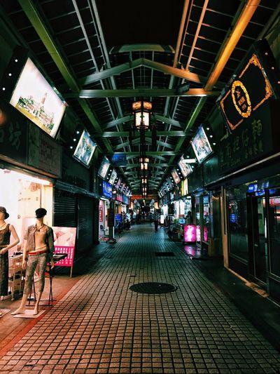 People in illuminated city