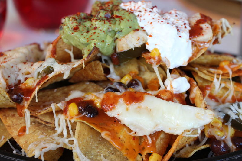 Nachos Close-up Day Daylight Food Food And Drink Freshness Guacamole Healthy Eating Homemade Indoors  Melted Cheese Mexican Food No People Plate Ready-to-eat Restaurant Serving Size Soured Cream Tortilla - Flatbread