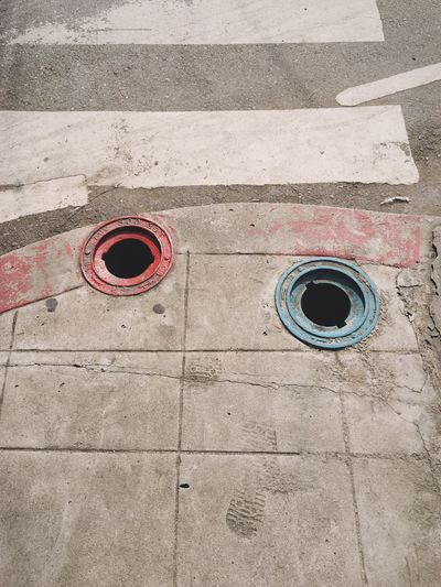 High angle view of holes at sidewalk