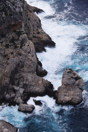Rock Water Rock - Object Solid Sea Beach Rock Formation Beauty In Nature High Angle View Scenics - Nature Coastline Eroded