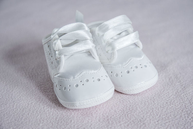 Little baby shoes Pair Healthcare And Medicine Sand Close-up