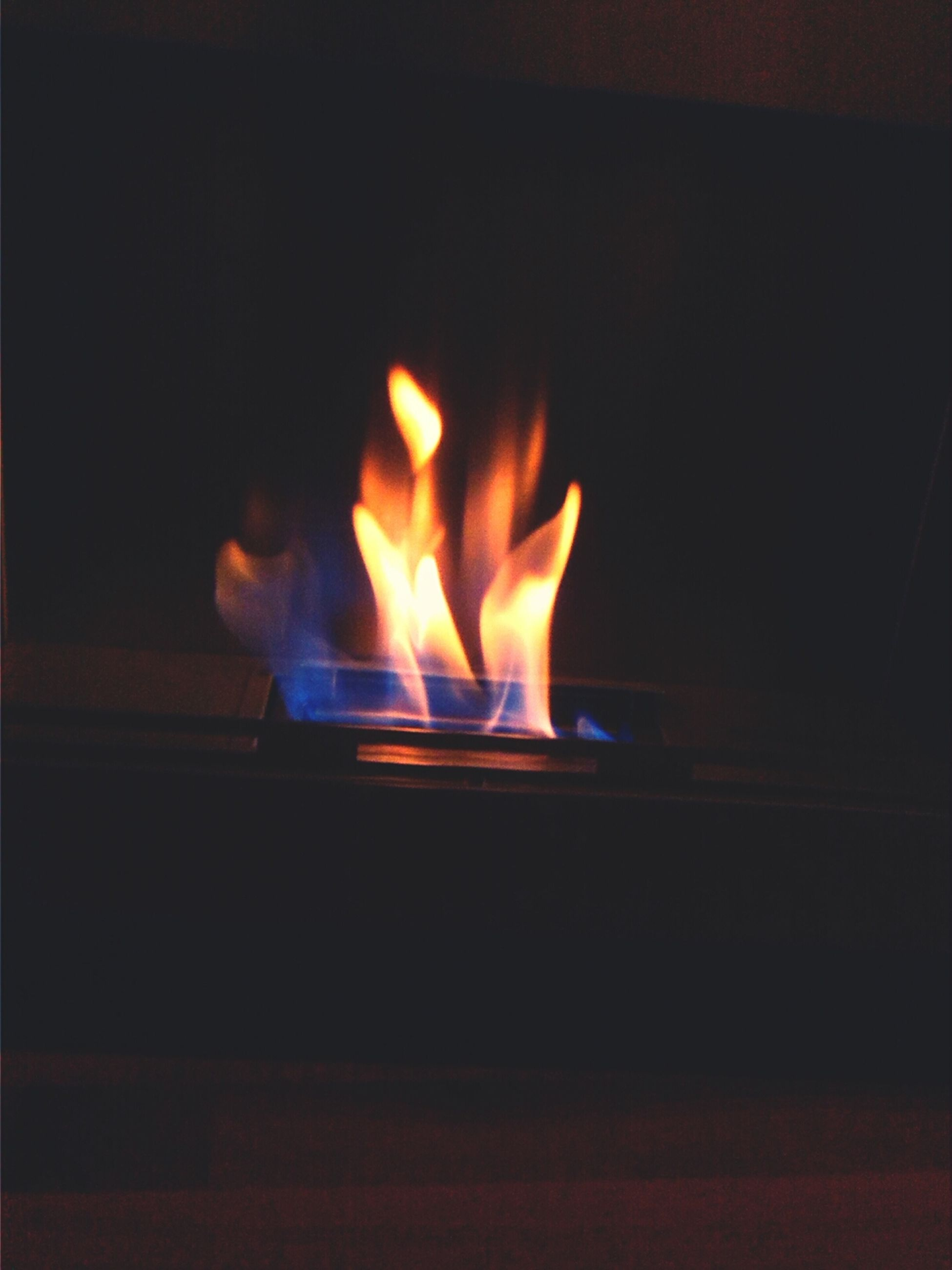 flame, burning, fire - natural phenomenon, illuminated, heat - temperature, glowing, night, dark, indoors, candle, fire, lit, copy space, close-up, light - natural phenomenon, orange color, no people, darkroom, candlelight, motion