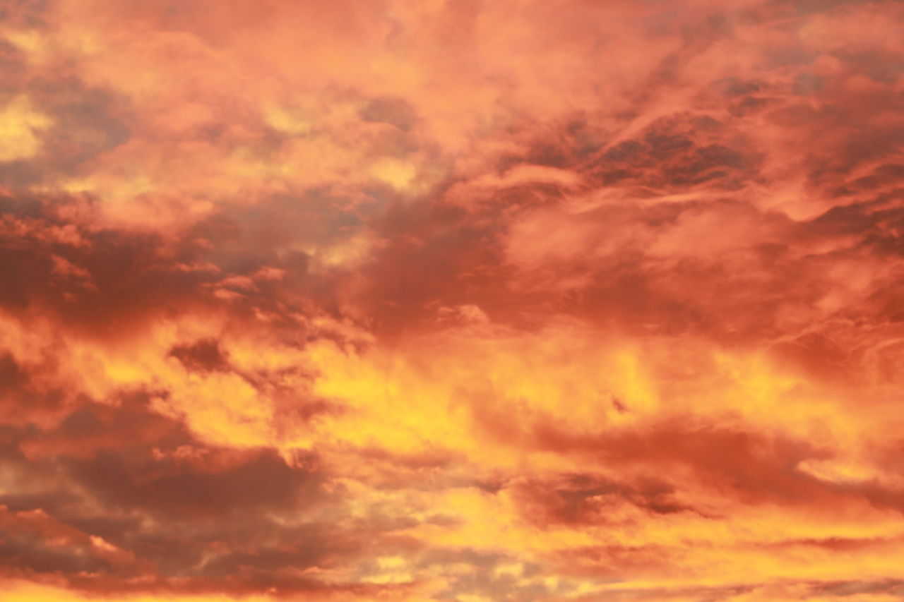 sunset, cloud - sky, orange color, sky, nature, dramatic sky, beauty in nature, backgrounds, low angle view, scenics, sky only, tranquil scene, tranquility, idyllic, outdoors, full frame, abstract, no people, day