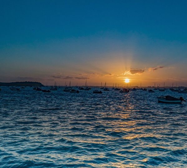 Sunset Nautical Vessel Sea Transportation Mode Of Transport Sky Beauty In Nature Tranquility Water Scenics No People Nature Outdoors Sun Tranquil Scene Sailboat Blue Waterfront Travel Destinations Moored Poole Harbour