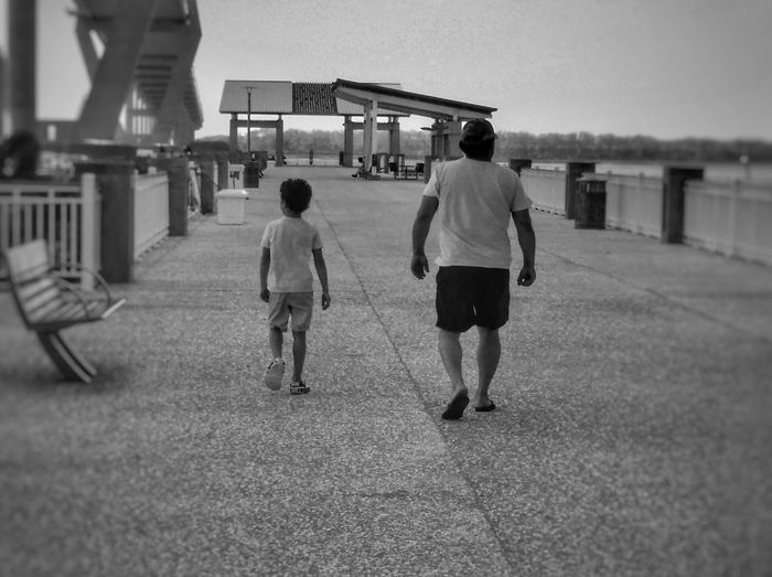 This Is Family Father & Son Father And Son Charleston Blackandwhite Togetherness Walkwithme Love True Love Outdoors Looking Back In Sync Growing Up Full Length Togetherness Bridge - Man Made Structure Walking Rear View Sky Architecture Footpath Summer Exploratorium EyeEmNewHere