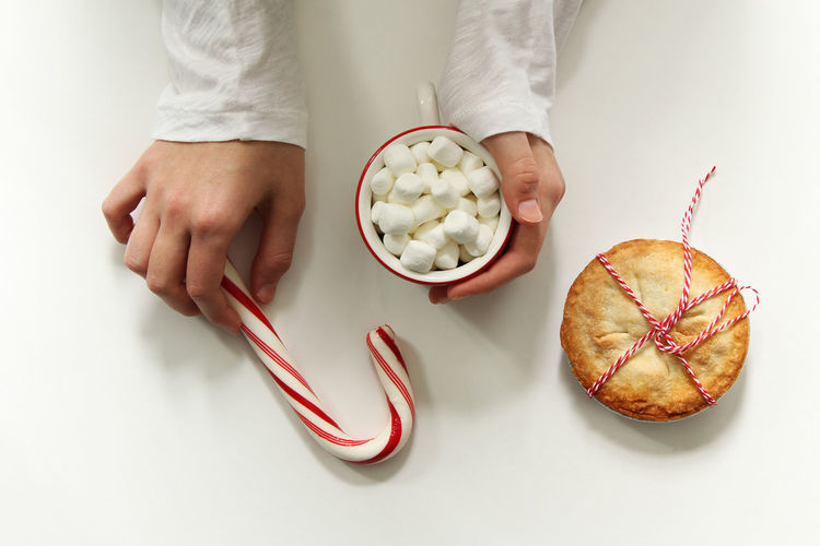 Christmas treats Christmas Marshmallow Snack Winter Above Concert Design Female Festive Flat Lay Food Food And Drink Freshness Holding Hot Chocolate Hot Drink Human Body Part Human Hand One Person People Pie Season  Studio Shot Sweets White Background