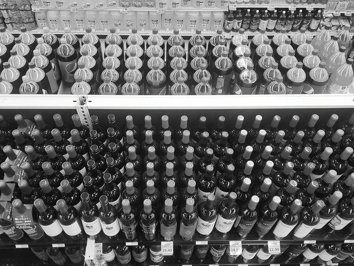 Full frame shot of bottles arranged in store