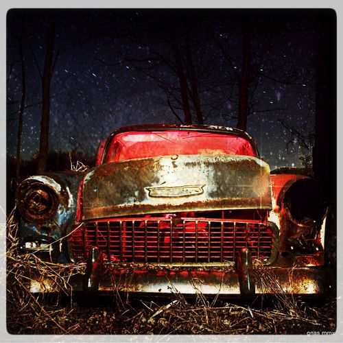 56 Chevy parked to rot behind a barn left to rot into the ground Abandoned Wisconsin Night Photography Long Exposure