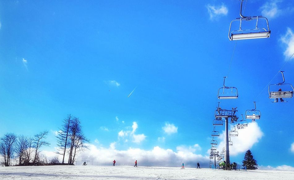 Low lying clouds. Beautiful Day Blue Sky White Clouds Blues Sky Family Skiing Holiday Winter Ski Resort  Snowcapped Mountain Snow Covered Chair Lift Sky Outdoors Blue Travel Destinations Skiing Winter Sports Snow Mountain Shades Of Winter An Eye For Travel Colour Your Horizn