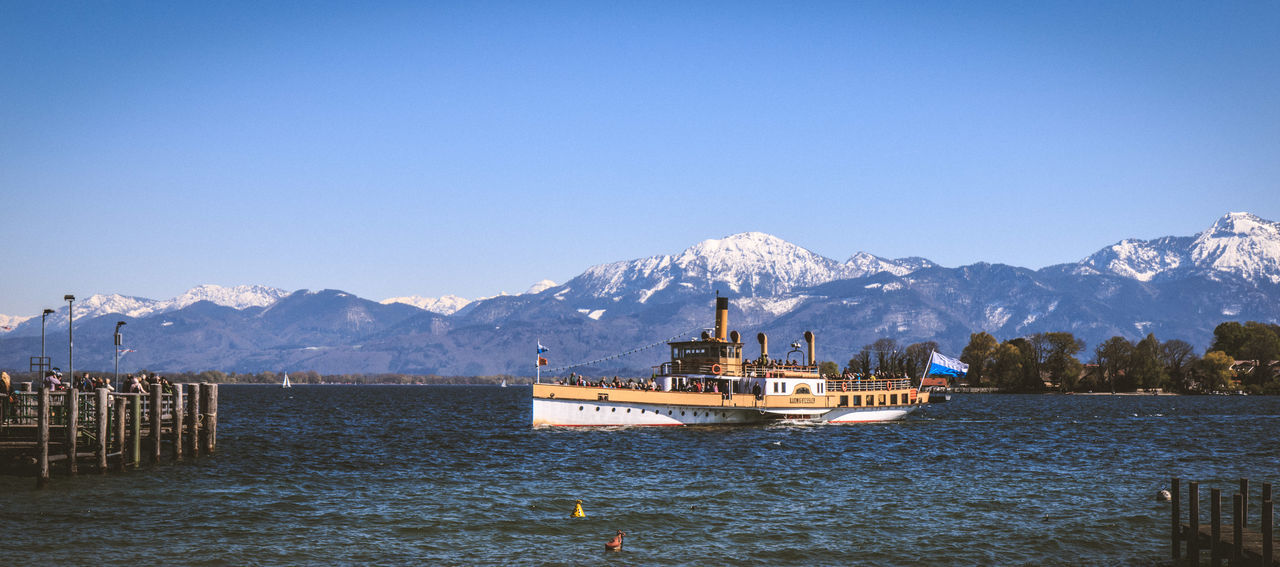 Raddampfer Ludwig Fessler Architecture Beauty In Nature Blue Clear Sky Cold Temperature Day EyeEm Best Shots Lake Mountain Mountain Range Nature Nautical Vessel No People Outdoors Scenics Sky Snow Snowcapped Mountain Steamboat Tranquil Scene Tranquility Transportation Water Winter