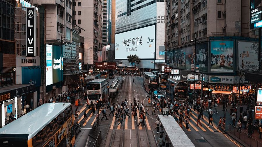 City Architecture Crowd Large Group Of People Built Structure Group Of People EyeEmNewHere Building Exterior Street Communication Text City Life Real People City Street Sign Transportation Walking Advertisement Men Building Road