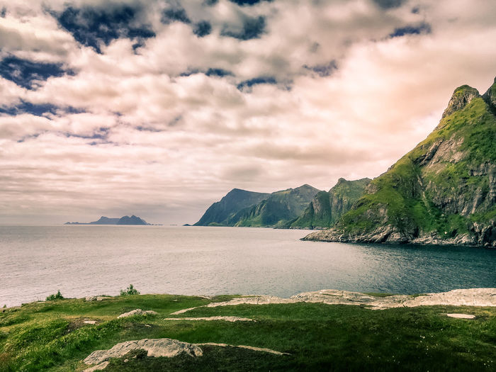 Sky Cloud - Sky Beauty In Nature Mountain Scenics - Nature Tranquility Tranquil Scene Water Nature No People Non-urban Scene Idyllic Sea Mountain Range Remote Day Environment Land Rock Outdoors Mountain Peak Ocean Fjord Lofoten Lofoten Islands Polar Circle Tranquility Travel Destinations