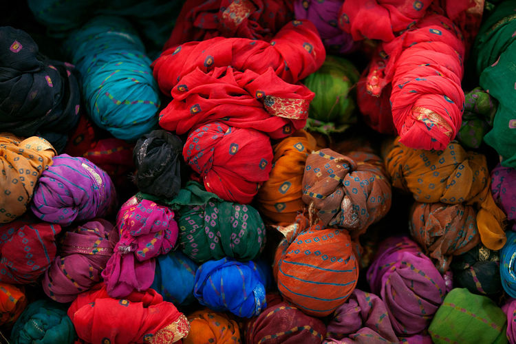 Abundance Arrangement Backgrounds Choice Close-up Colorful Display Full Frame Heap Market Merchandise Multi Colored No People Orange Color Red Repetition Saree Stack Still Life Textile Variation