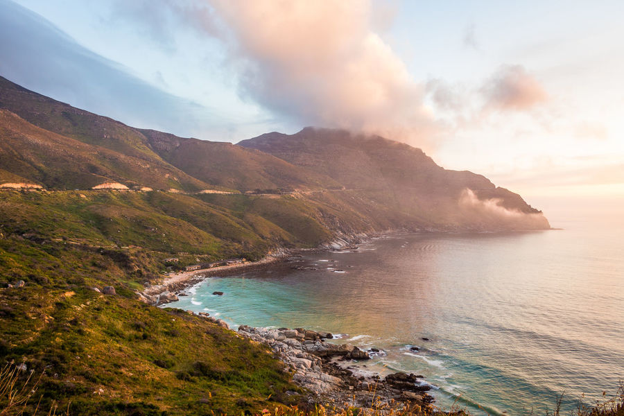 A Golden Hour Chapmans Peak Light Beach Beautiful Colours Beauty In Nature Cape Town, South Africa Chapmans Peak Cliffs Colours Of Nature Dramatic Sky Landscape Mountain Ocean View Outdoors Scenics Sea Sunset Travel Destinations Turqouise Water Vacations Water