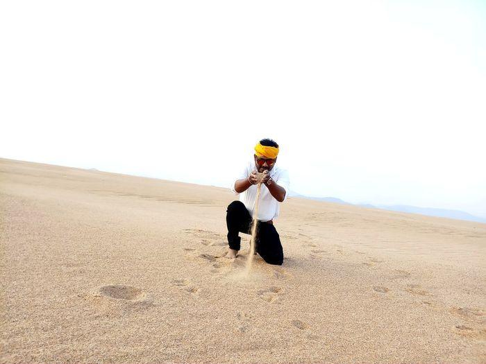 Full length of a man on desert