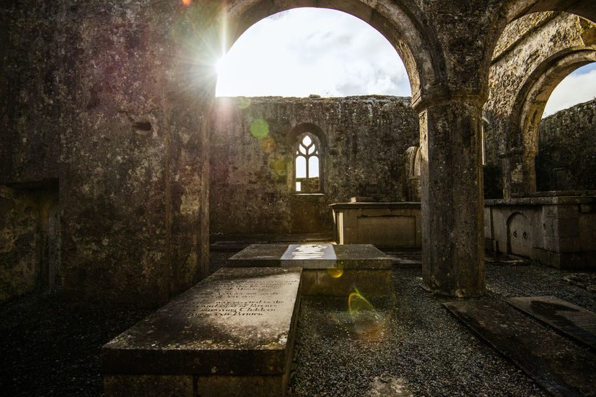 14th Century Abandoned Abbey Abbey Ruins Arch Architecture Architecture Built Structure Clare County Column Day Flare Graves Indoors  Ireland No People Old Ruin Place Of Worship Quin Abbey Religion Ruins Spirituality Sunlight