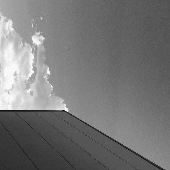 clouds and a building Building Exterior No People Sky Built Structure Architecture Day Outdoors Low Angle View Nature Blackandwhite Monochrome Clouds And Sky Building Streetphotography