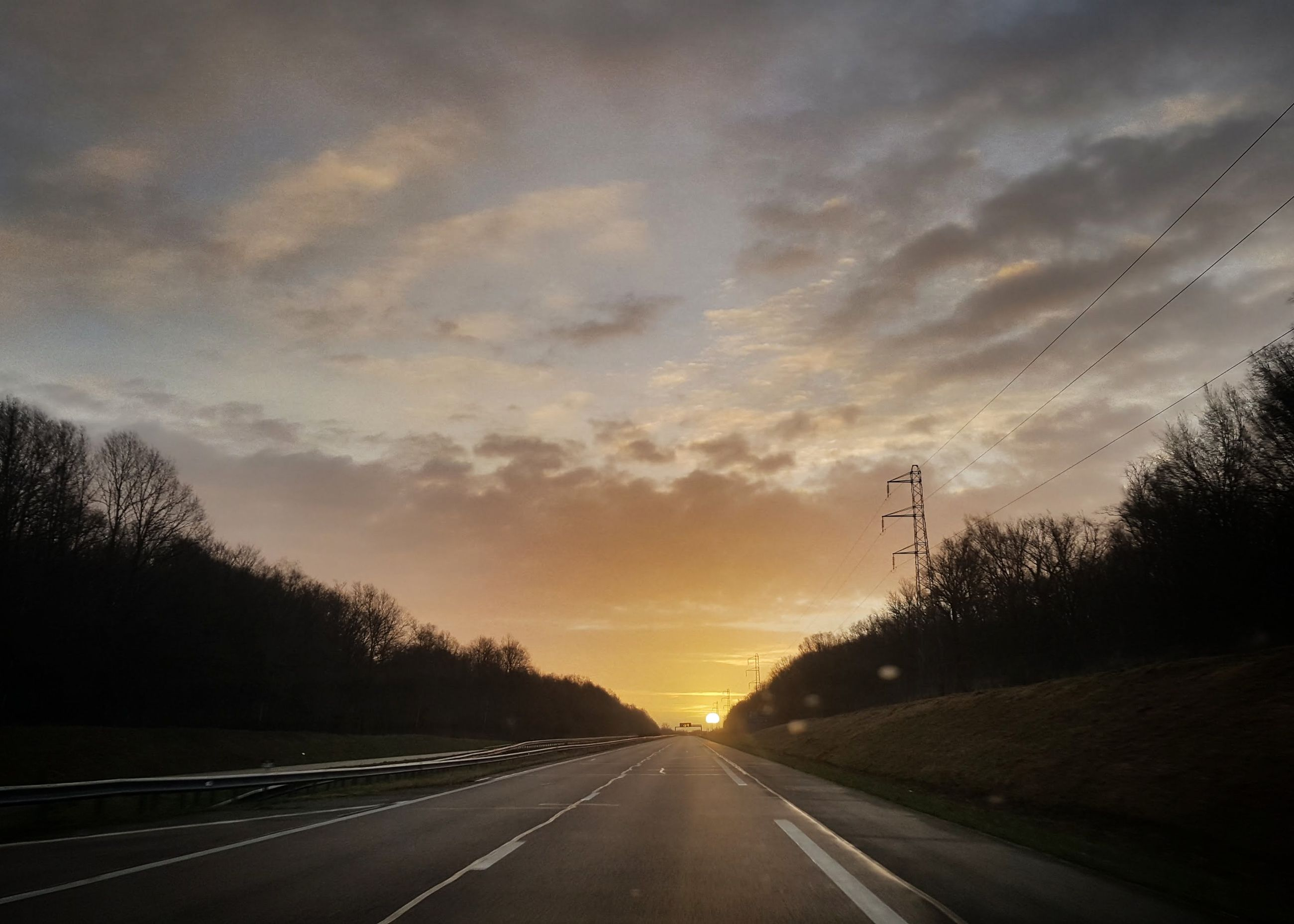 road, the way forward, transportation, road marking, sunset, sky, no people, cloud - sky, tranquility, tranquil scene, nature, tree, silhouette, scenics, dividing line, outdoors, landscape, beauty in nature, day