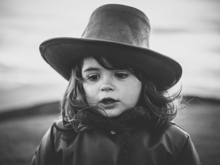 Innocence Hair Candid Portraits Bnw_friday_eyeemchallenge Bnwphotography Females Cowboy Hat Lifestyles Innocence Close-up Front View Real People Headshot One Person Portrait Childhood Child Clothing Hat Girl Outdoors Human Face Head And Shoulders Ranch Horseback Riding Monochrome Hazel Eyes  Eye International Women's Day 2019