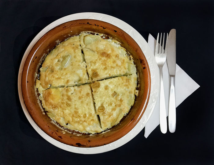 Spanish omelet, tortilla espanola Black Background Close-up Day Directly Above Food Food And Drink Fork Freshness Healthy Eating High Angle View Indoors  Knife Napkin No People Plate Ready-to-eat Still Life Table Tortilla Tortilla Española