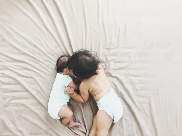 Learning Siblings Friendship Children Baby Girl Baby Newborn Resting Bed NewBorn Photography Bed Baby Love Young Sleeping Child Childhood Real People Bonding Togetherness Two People Lying Down Indoors  Babyhood High Angle View Females